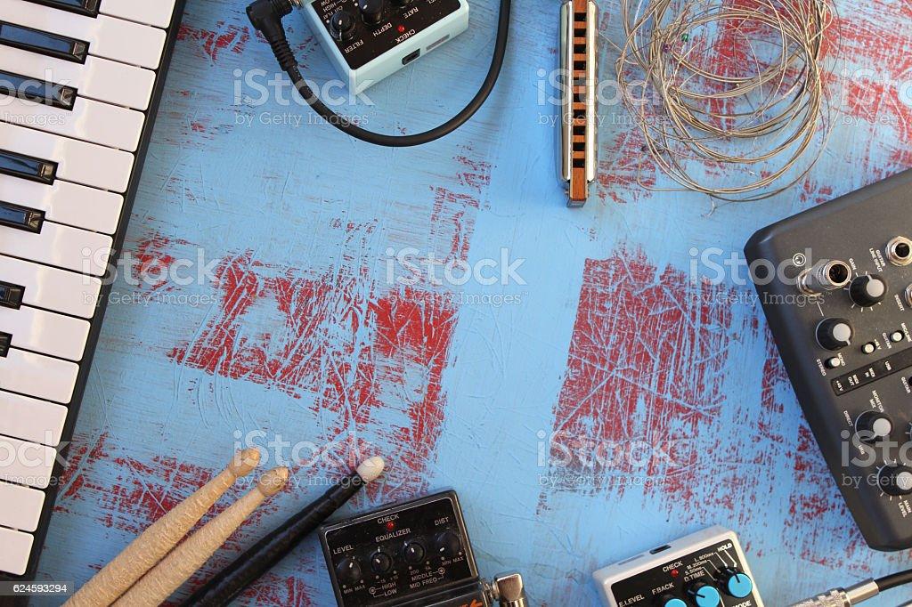 Guitar pedal, harmonica, piano key, audio card and drum stick stock photo