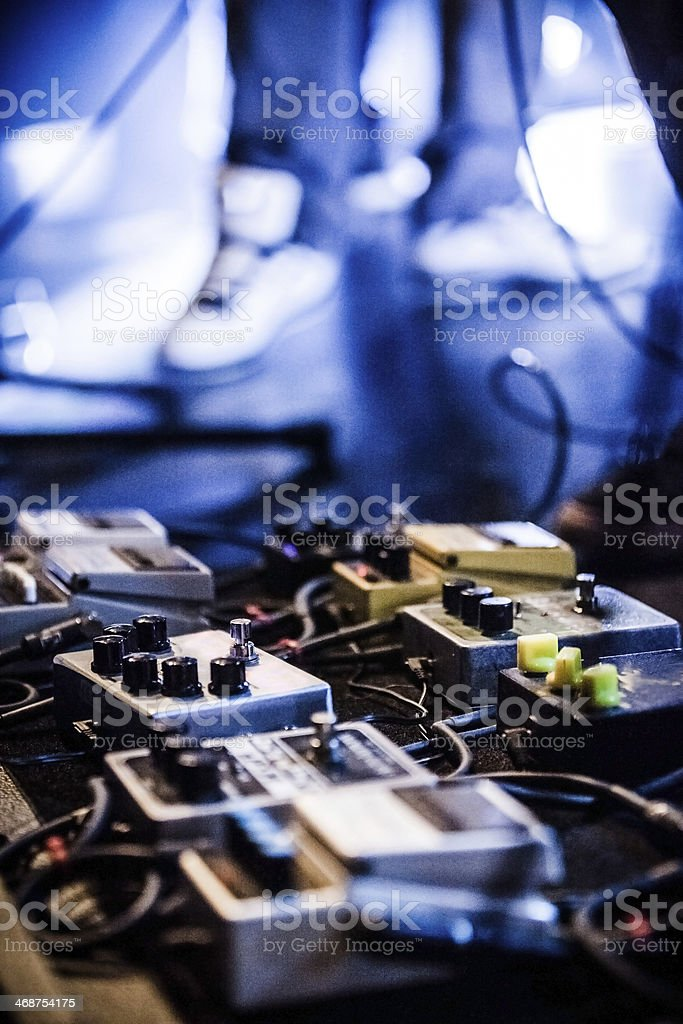 Guitar Pedals on a stage with live band performing stock photo