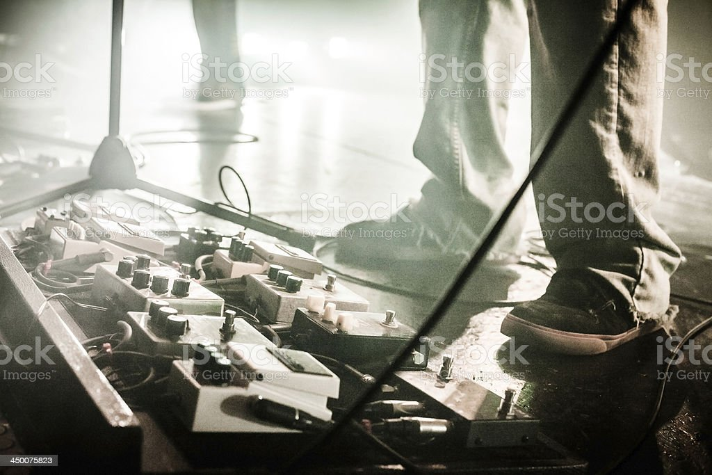 Guitar Pedals on stage with live band performing stock photo