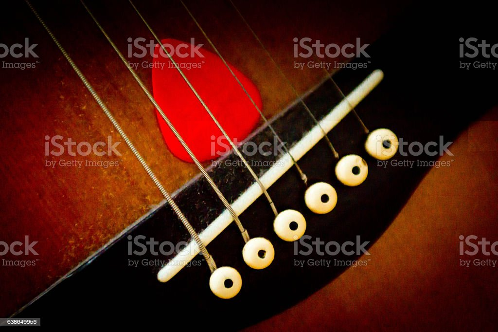 Guitar pick and strings stock photo