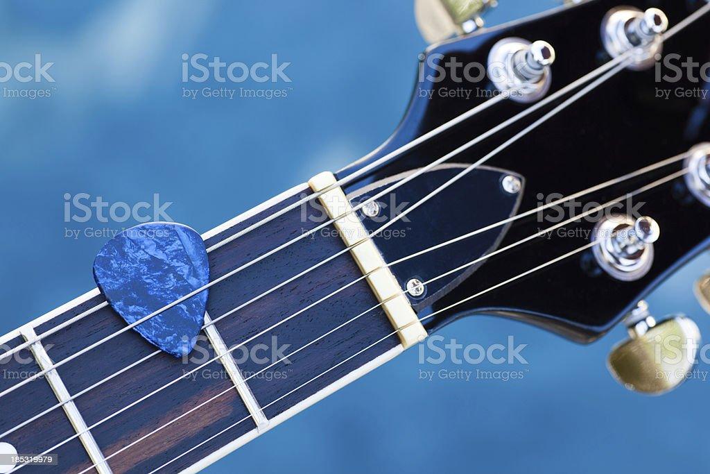 Guitar Pick in Strings stock photo