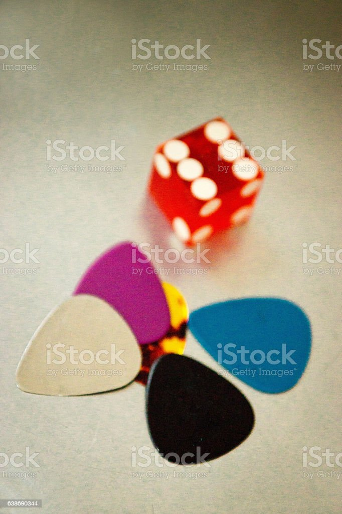 Guitar picks on a table top stock photo