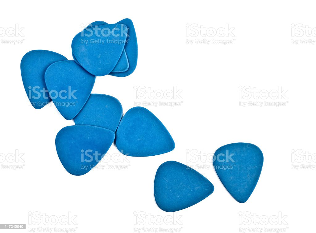 Guitar picks on white with copy space stock photo