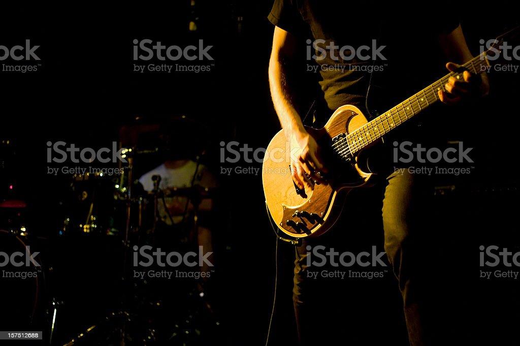 guitar player close up at a rock show stock photo