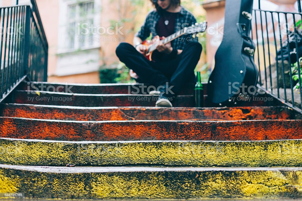 Guitar player outside stock photo