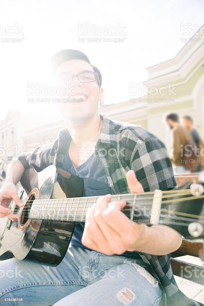 Guitar Player Singing Outdoors stock photo