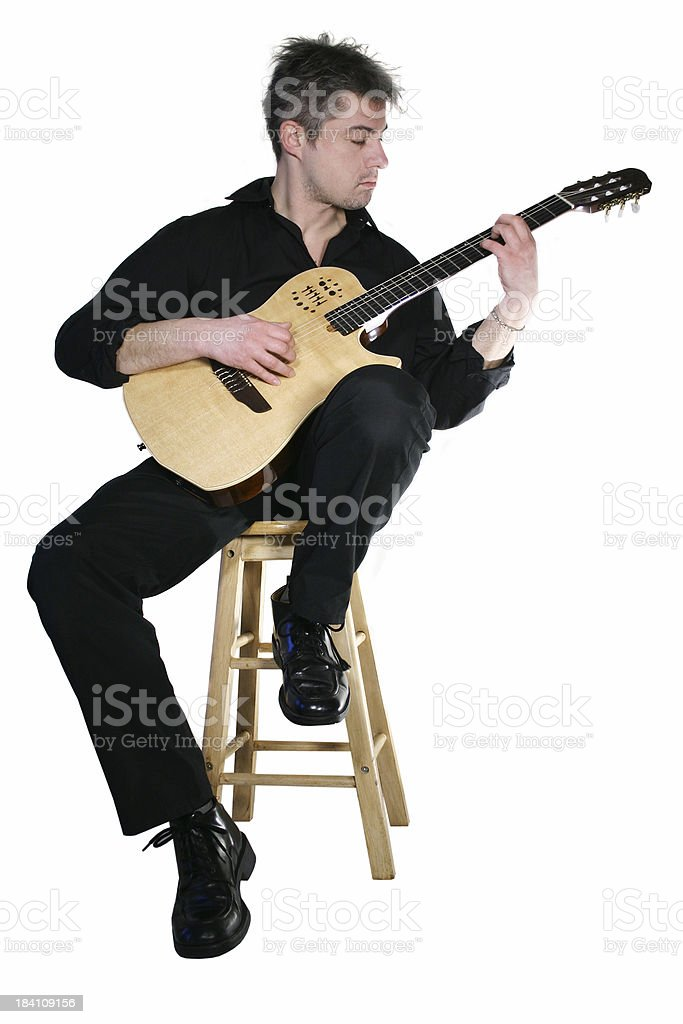 Guitar player sitting (isolated) stock photo