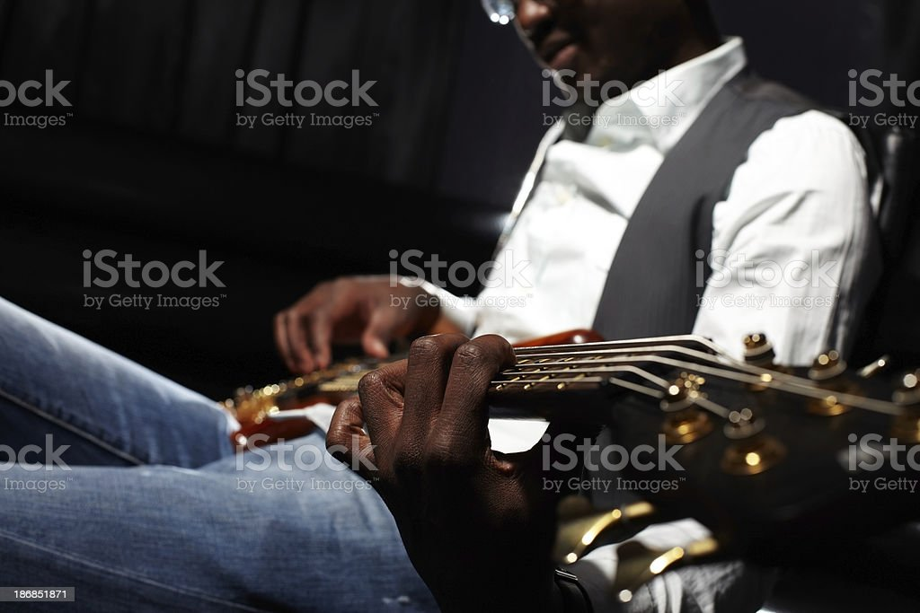 Guitar playing stock photo