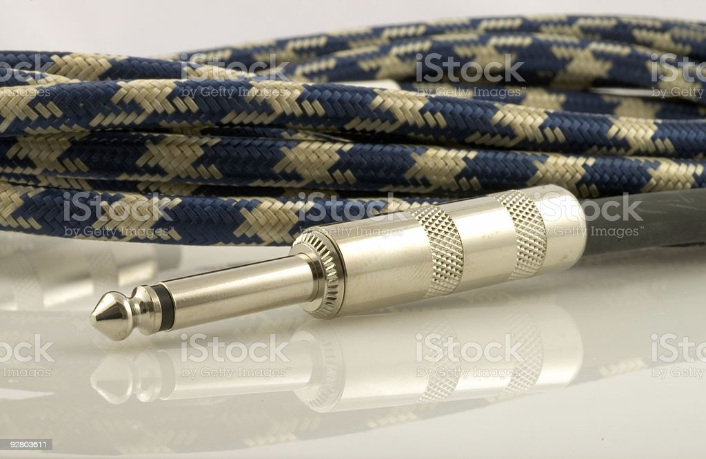 Guitar plug and cable royalty-free stock photo