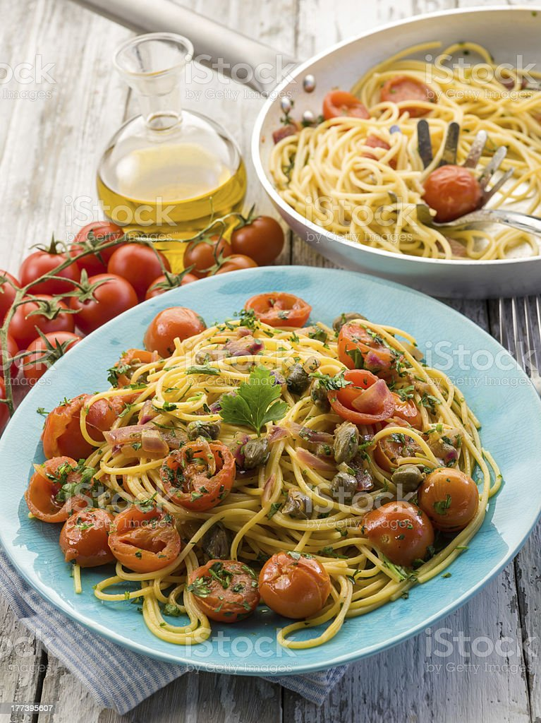 guitar spaghetti with pachino tomatoes and capers royalty-free stock photo
