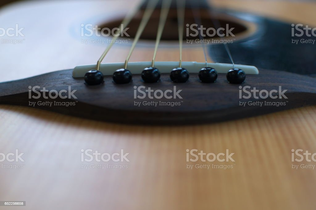 Guitar strings viewed from bottom stock photo