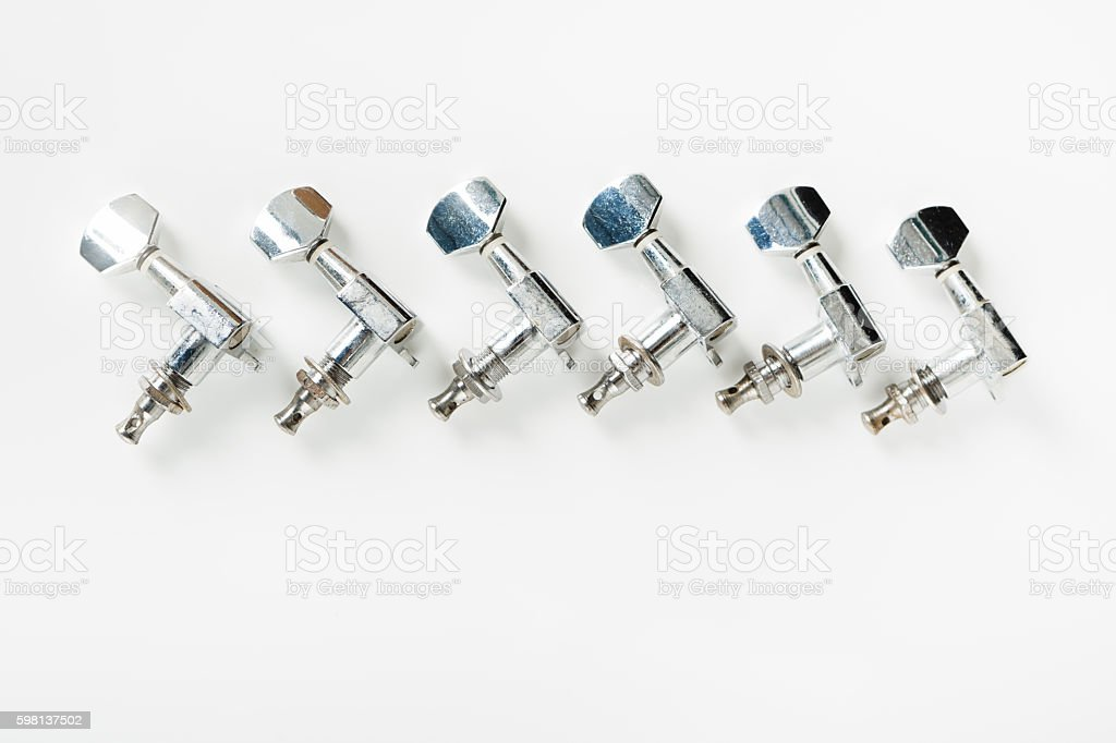Guitar tuners in a row stock photo