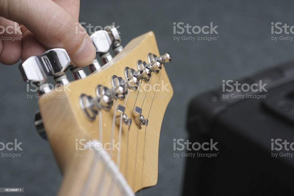Guitar tuning stock photo