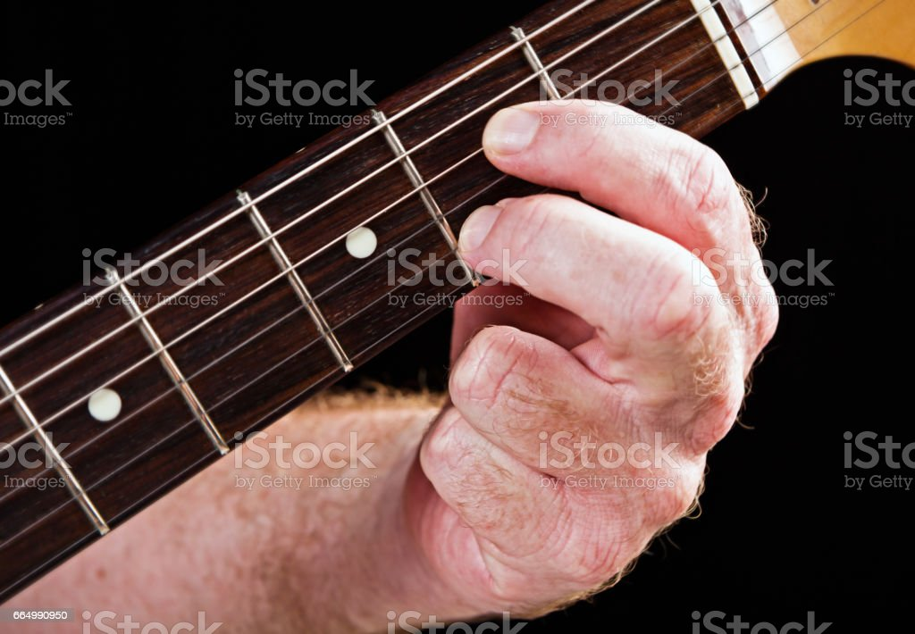 Guitar tutorial: A dominant seventh demonstration on electric guitar stock photo