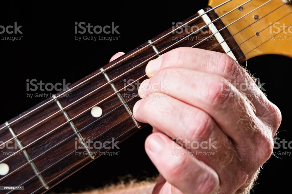 Guitar tutorial: A major chord demonstration on electric guitar stock photo