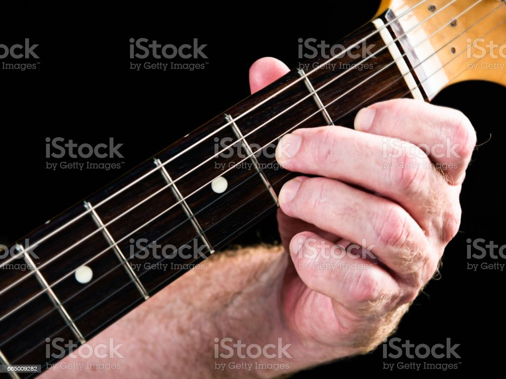 Guitar tutorial: A major seventh demonstration on electric guitar stock photo