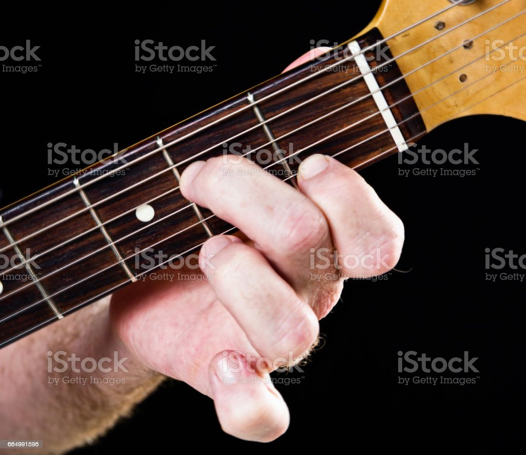 Guitar tutorial: A minor seventh demonstration on electric guitar stock photo