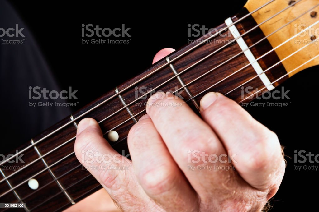 Guitar tutorial: A minor with C bass note demonstration stock photo