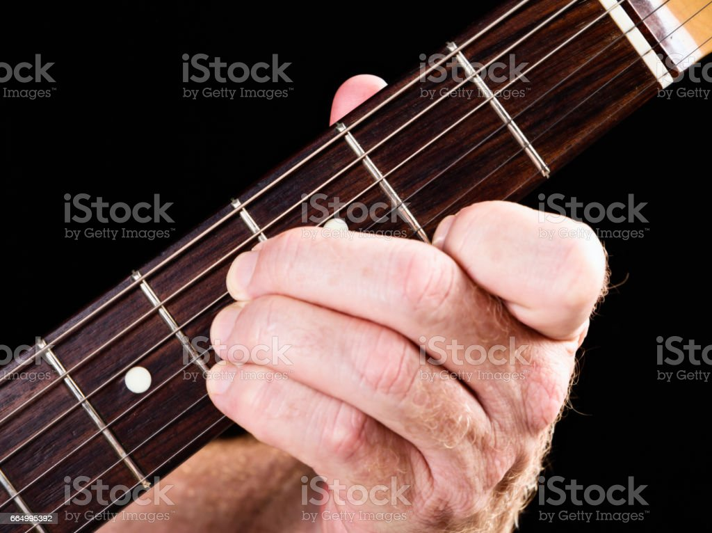 Guitar tutorial: B major chord demonstration on electric guitar stock photo