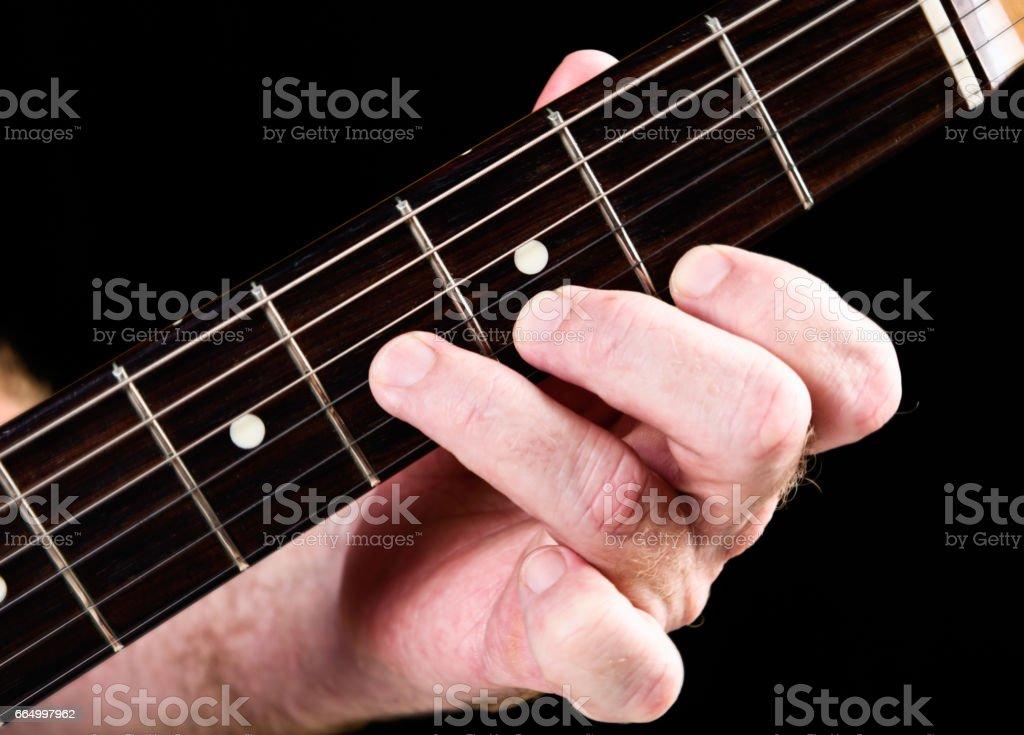 Guitar tutorial: B minor chord demonstration on electric guitar stock photo
