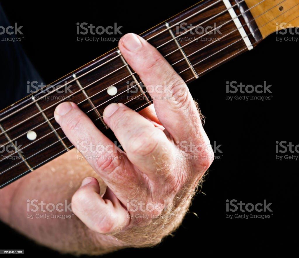 Guitar tutorial: B minor seventh demonstration on electric guitar stock photo
