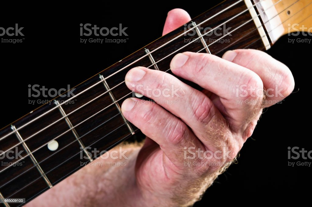 Guitar tutorial: C dominant seventh chord demonstrated on electric guitar stock photo