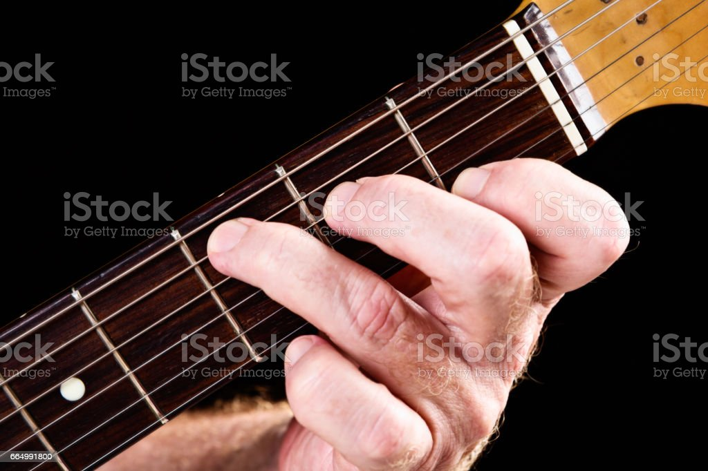 Guitar tutorial: C major chord demonstrated on electric guitar stock photo