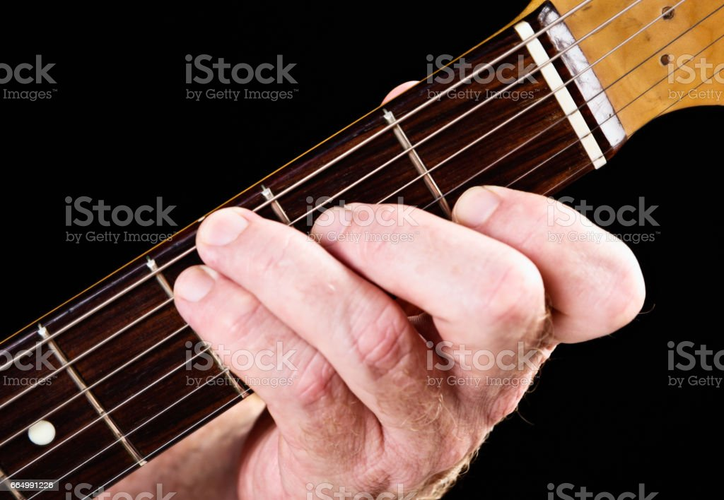 Guitar tutorial: C major chord variation demonstrated on electric guitar stock photo