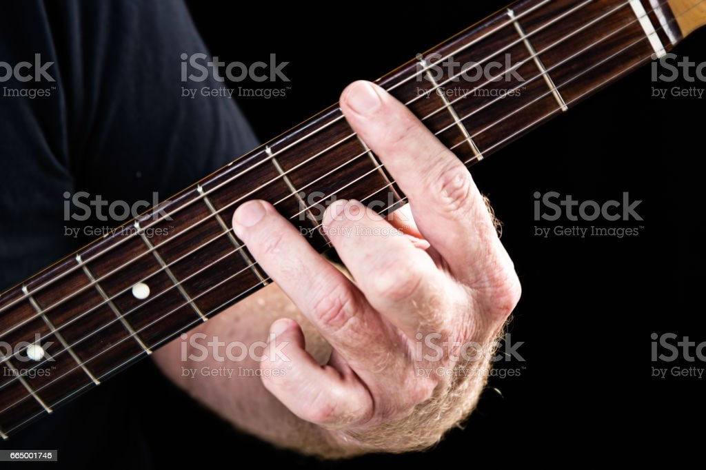 Guitar tutorial: C minor seventh chord demonstrated on electric guitar stock photo