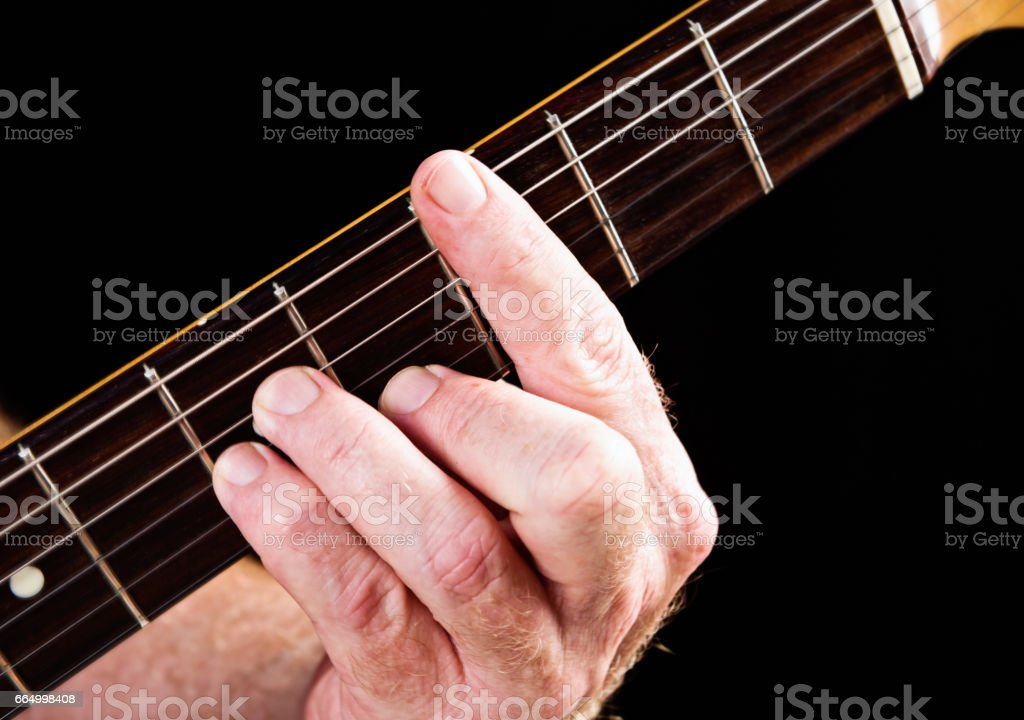 Guitar tutorial: C minor seventh demonstration on electric guitar stock photo