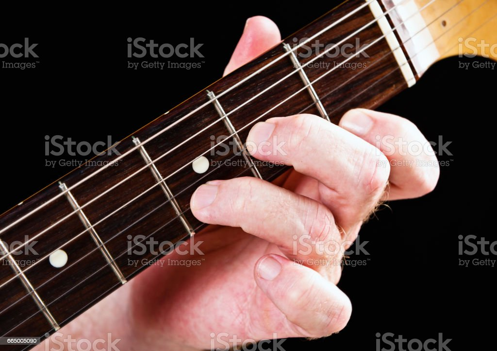 Guitar tutorial: D minor chord demonstration on electric guitar stock photo