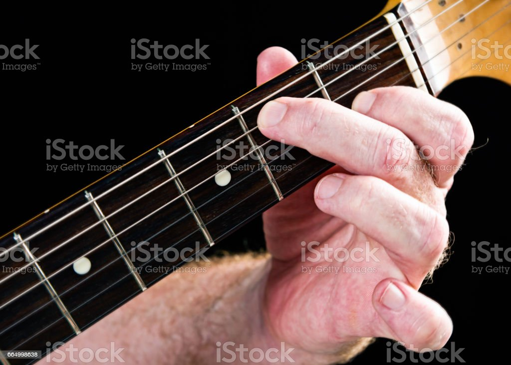 Guitar tutorial: E dominant seventh chord demonstrated on electric guitar stock photo