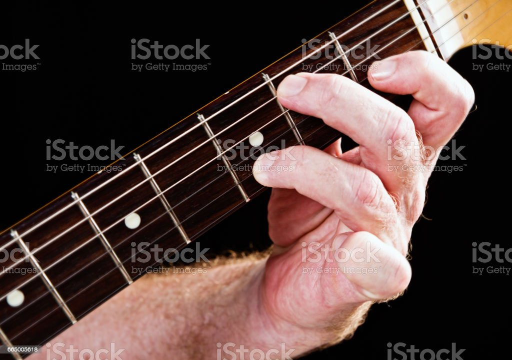 Guitar tutorial: E dominant seventh demonstration on electric guitar stock photo