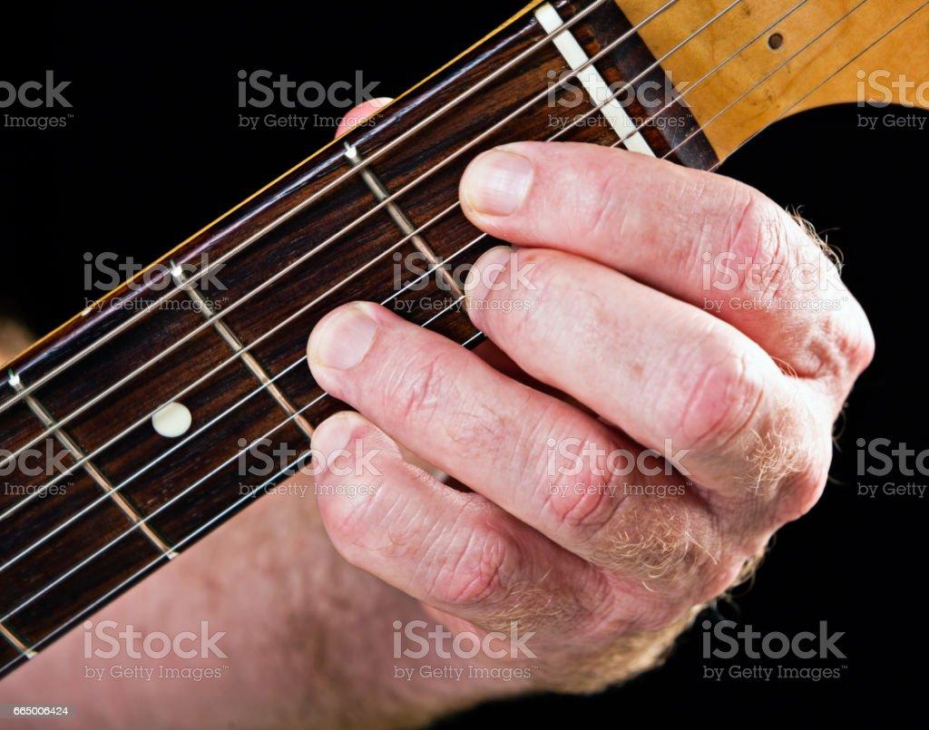 Guitar tutorial: E flat diminished seventh demonstration stock photo