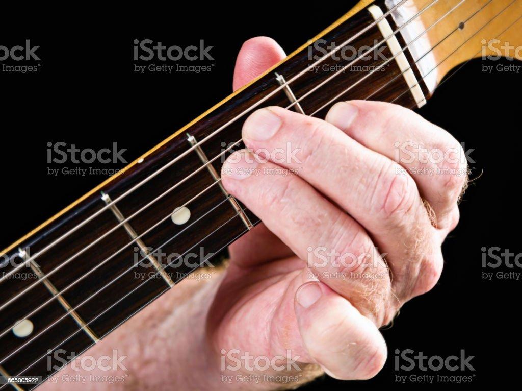 Guitar tutorial: E major chord demonstration on electric guitar stock photo