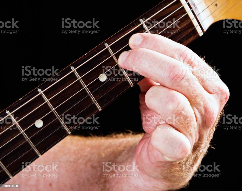 Guitar tutorial: E minor chord demonstration on electric guitar stock photo