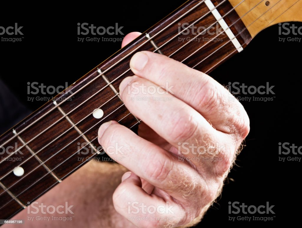 Guitar tutorial: E minor seventh demonstration on electric guitar stock photo