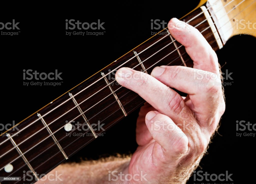 Guitar tutorial: F dominant seventh chord demonstrated on electric guitar stock photo