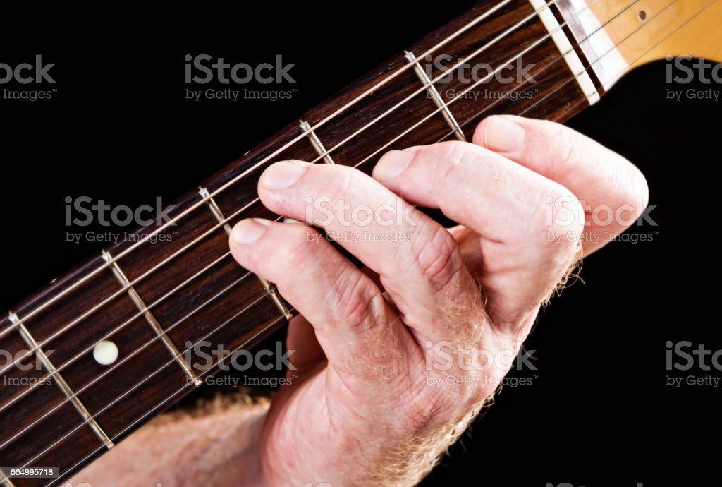 Guitar tutorial: F major chord alternative demonstration on electric guitar stock photo