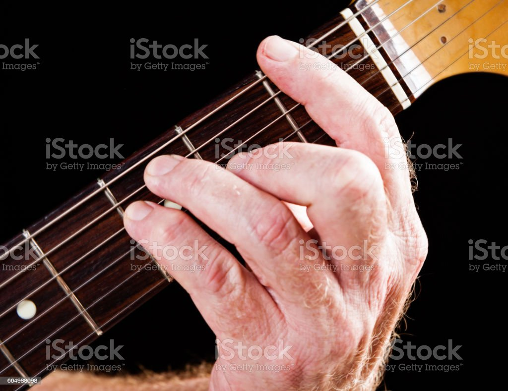 Guitar tutorial: F major chord demonstration on electric guitar stock photo