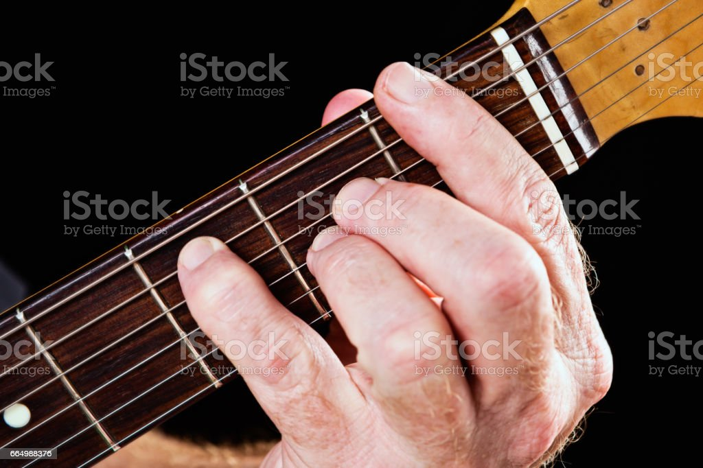 Guitar tutorial: F major seventh chord demonstrated on electric guitar stock photo