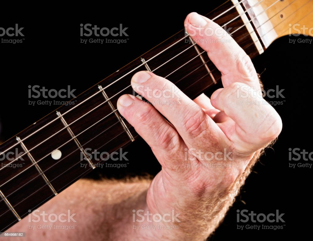 Guitar tutorial: F minor chord demonstration on electric guitar stock photo