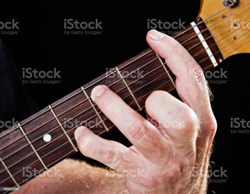 Guitar tutorial: F minor seventh demonstration on electric guitar stock photo