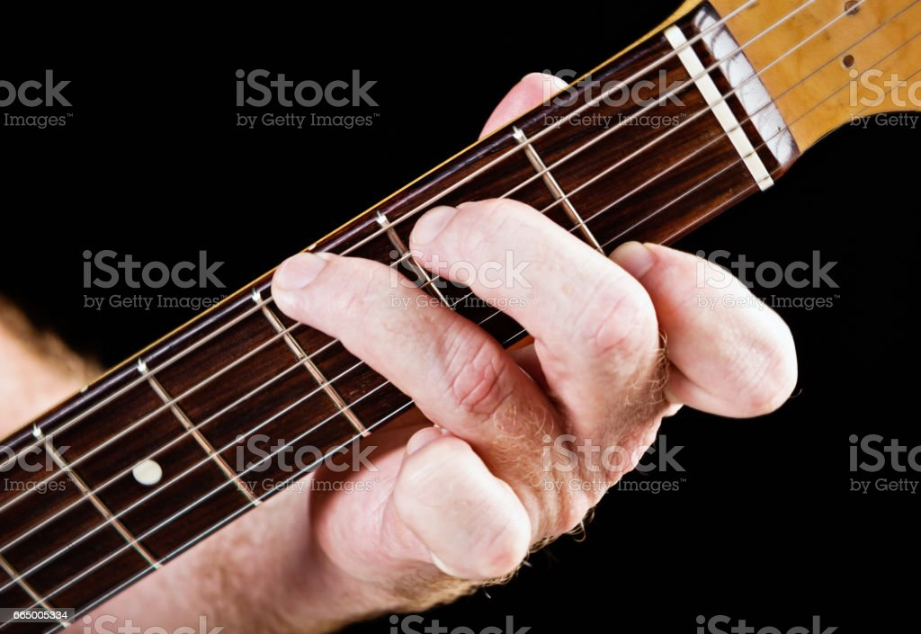 Guitar tutorial: G dominant seventh demonstration on electric guitar stock photo
