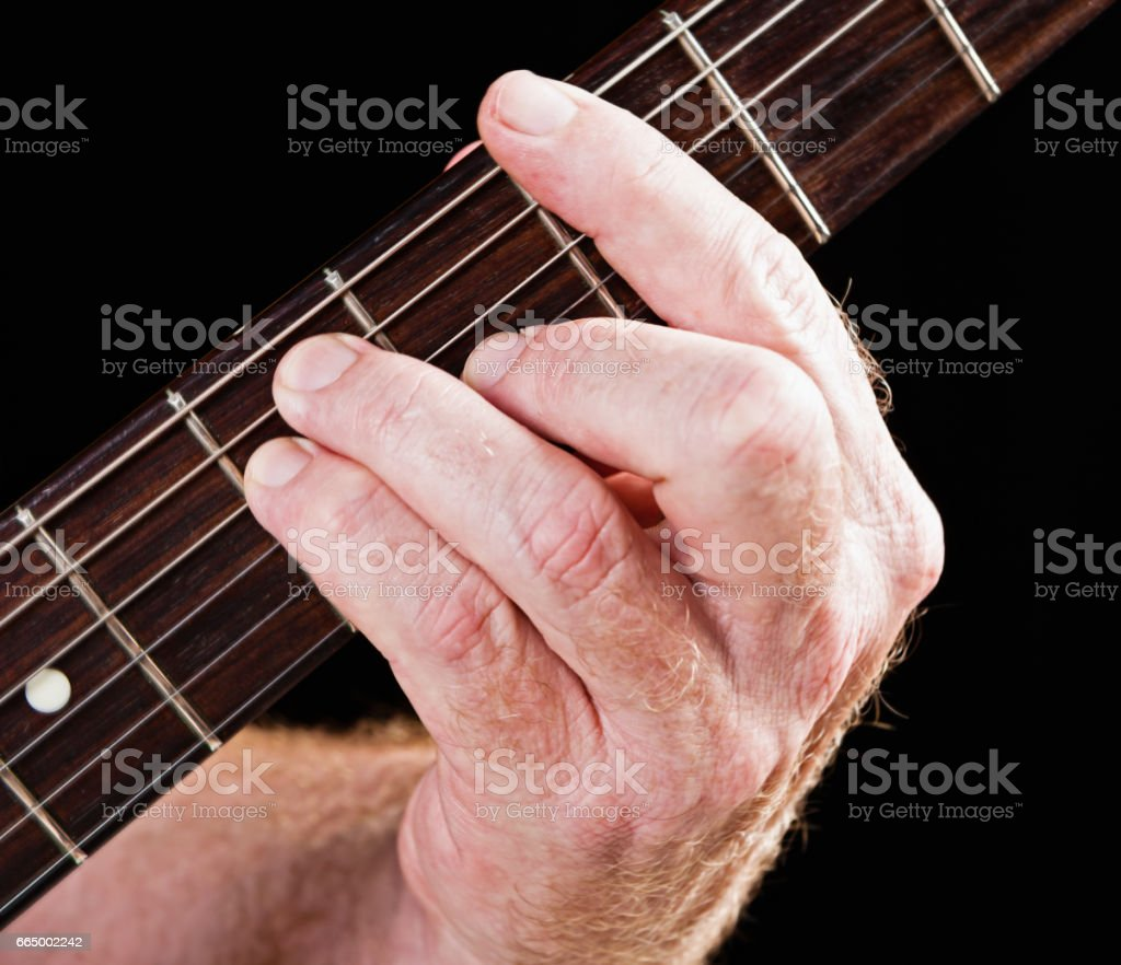 Guitar tutorial: G major chord barre version on electric guitar stock photo