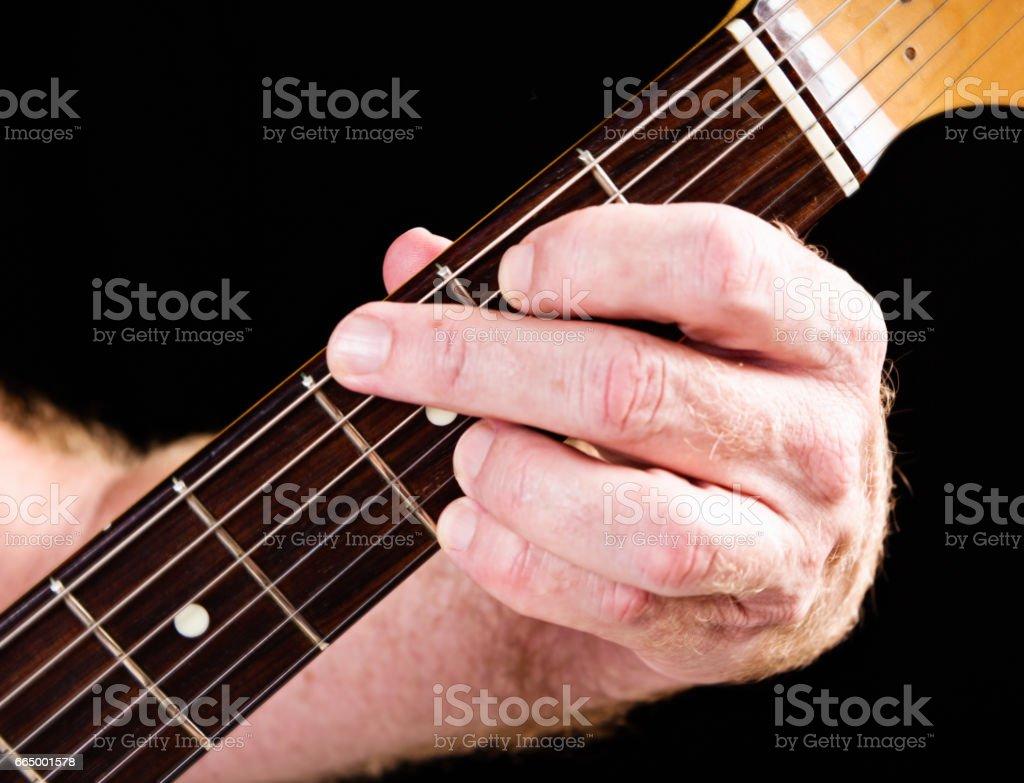 Guitar tutorial: G major chord four-finger version on electric guitar stock photo