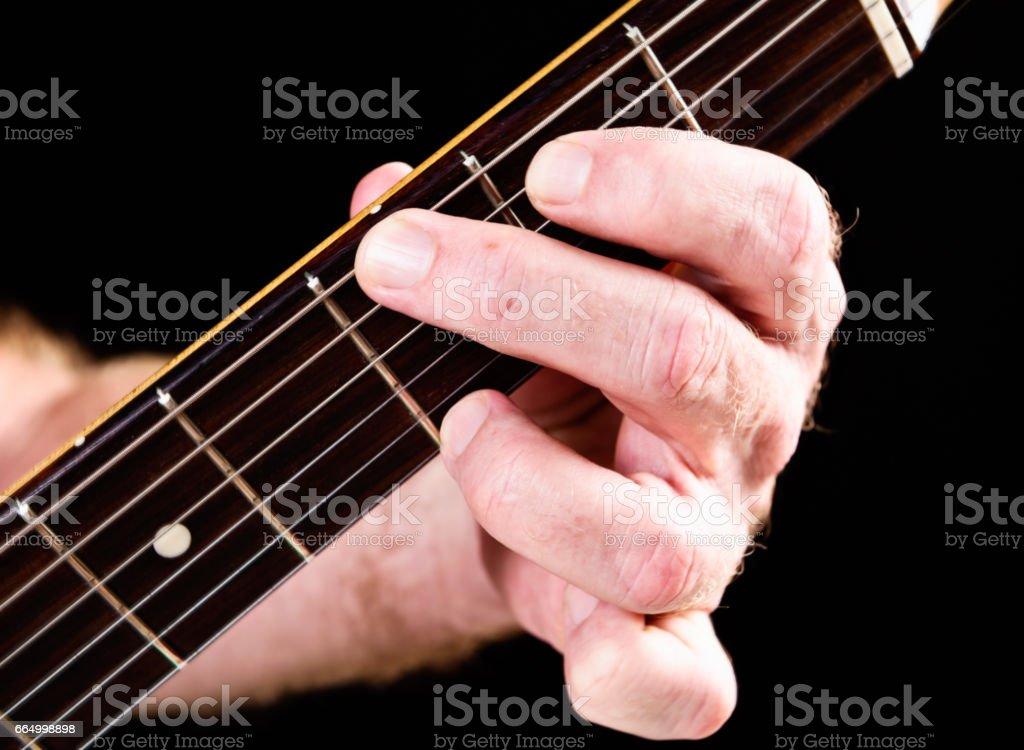 Guitar tutorial: G major chord standard version on electric guitar stock photo