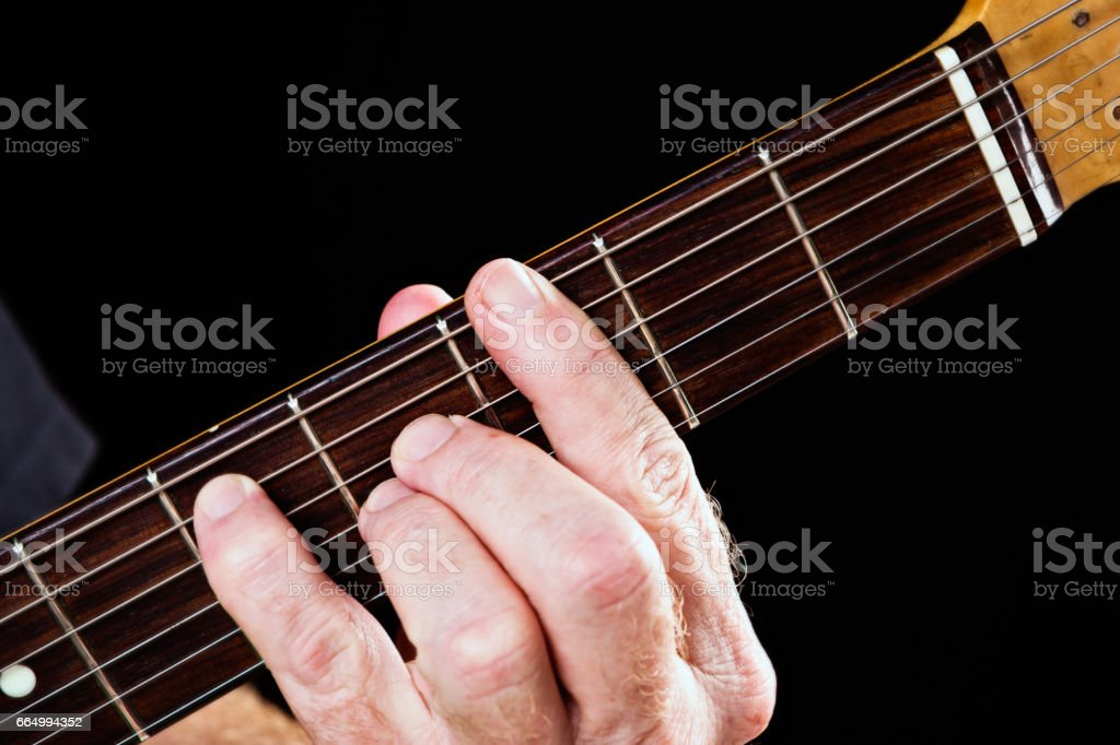 Guitar tutorial: G major seventh chord demonstrated on electric guitar stock photo