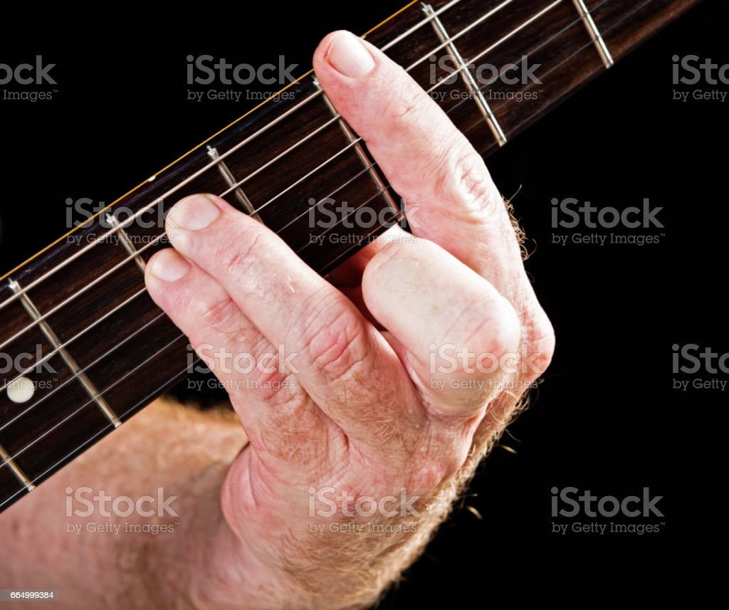 Guitar tutorial: G minor chord demonstration on electric guitar stock photo