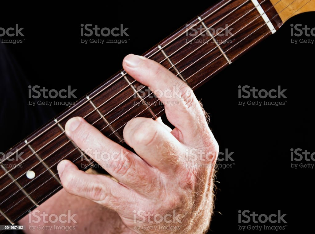 Guitar tutorial: G minor seventh demonstration on electric guitar stock photo
